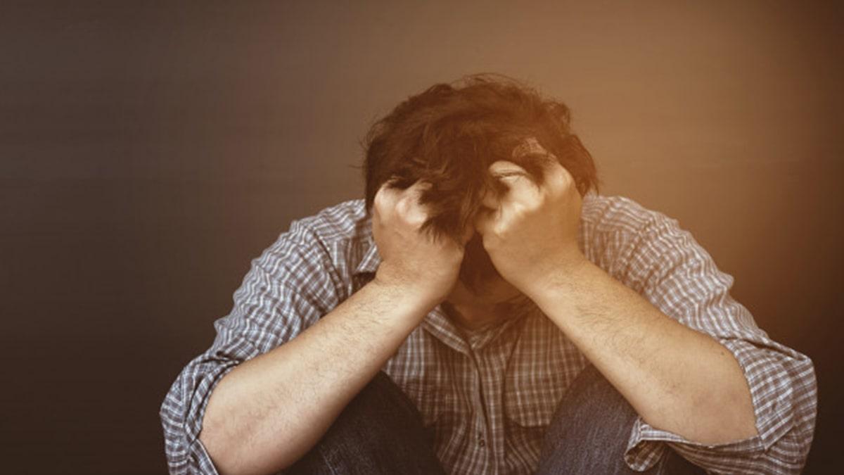 sad man sitting due to depression and sadness